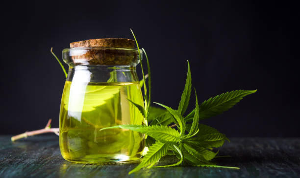 Cannabis oil and marijuana leaves stock photo