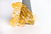 istock Cannabis oil concentrate aka shatter isolated over white 1292494333