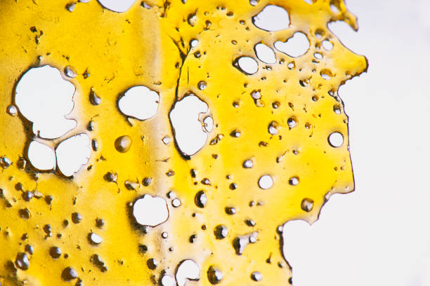 Cannabis oil concentrate aka shatter isolated stock photo