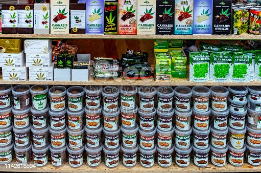 Cannabis types in shop window in Amsterdam where cannabis use is legalised. They include various types of cannabis laden cookies and chocolate bars.