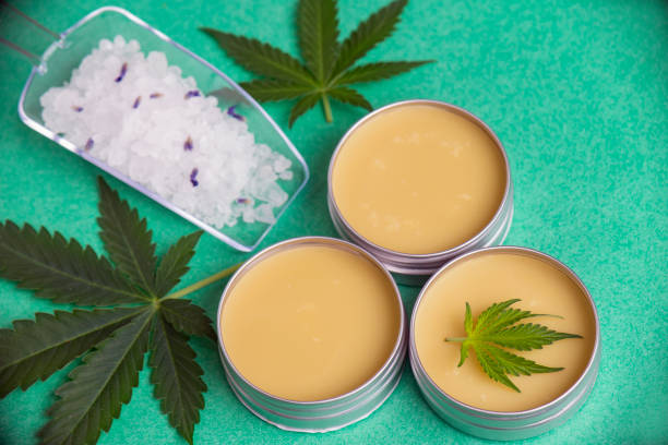 Cannabis wellness products with bath bomb, soaking salts and marijuana salve stock photo