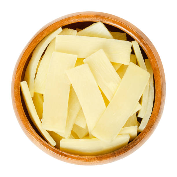 Canned bamboo shoots in wooden bowl over white stock photo