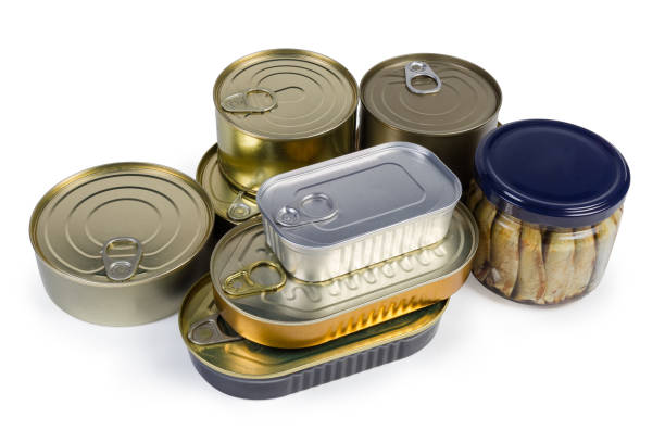 Canned fish in different sealed tin cans and glass jar stock photo