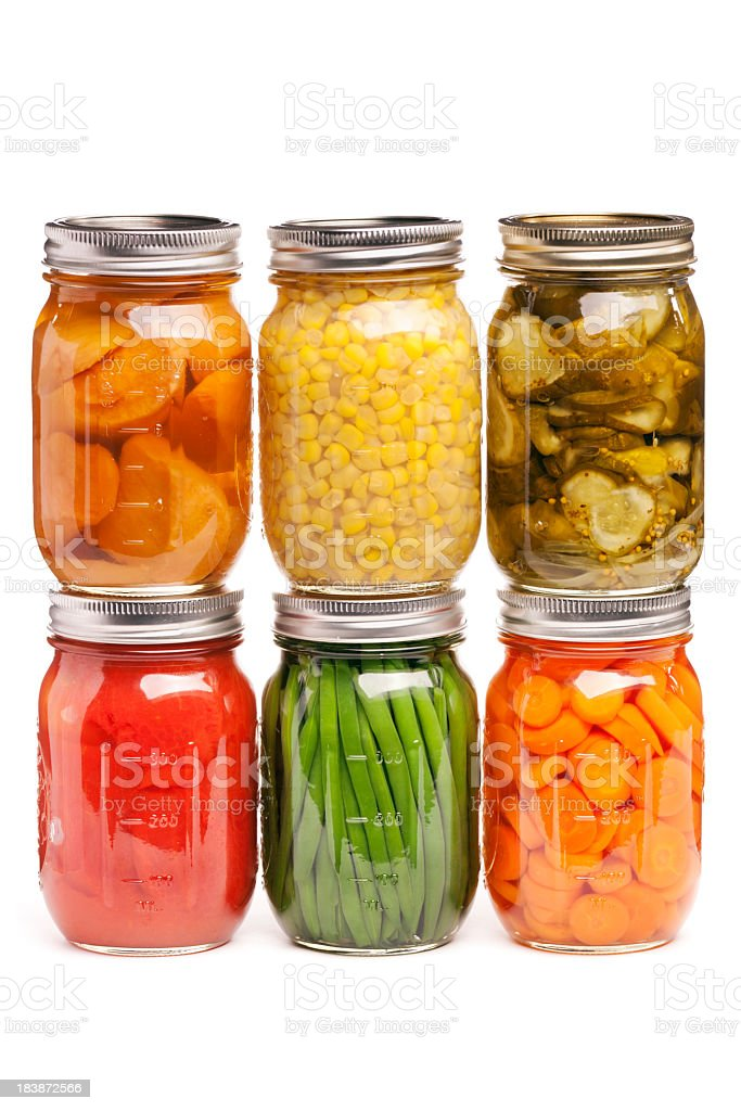 Canned Food, Glass Jar Containers of Preserved, Pickled Canning Vegetables stock photo