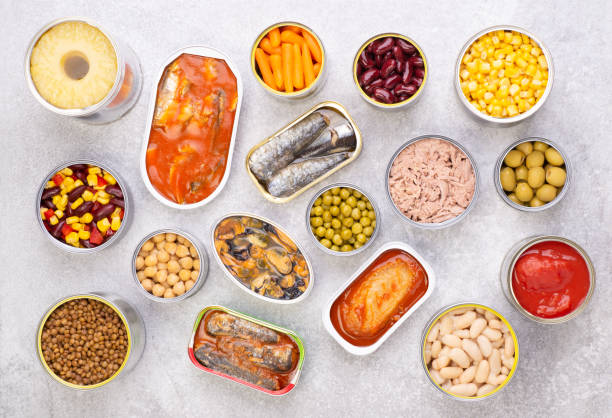 Canned food on gray background background stock photo