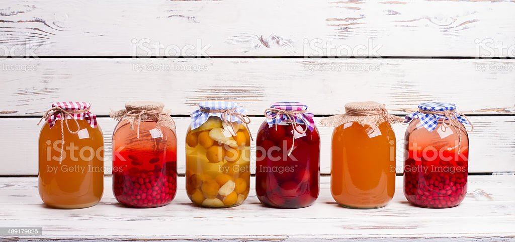 Canned fruit drinks in glass jars. stock photo