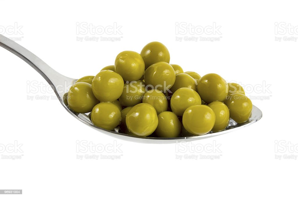 Canned green peas in a spoon royalty-free stock photo