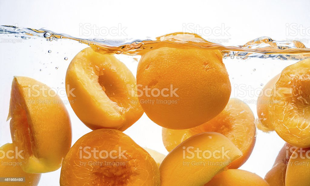 Canned peaches. Preserved fruit splash in water stock photo