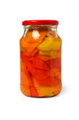Glass jar with canned sweet peppers isolated on white