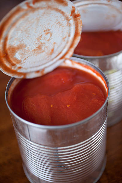 canned tomatoes - tomato can stock photos and pictures