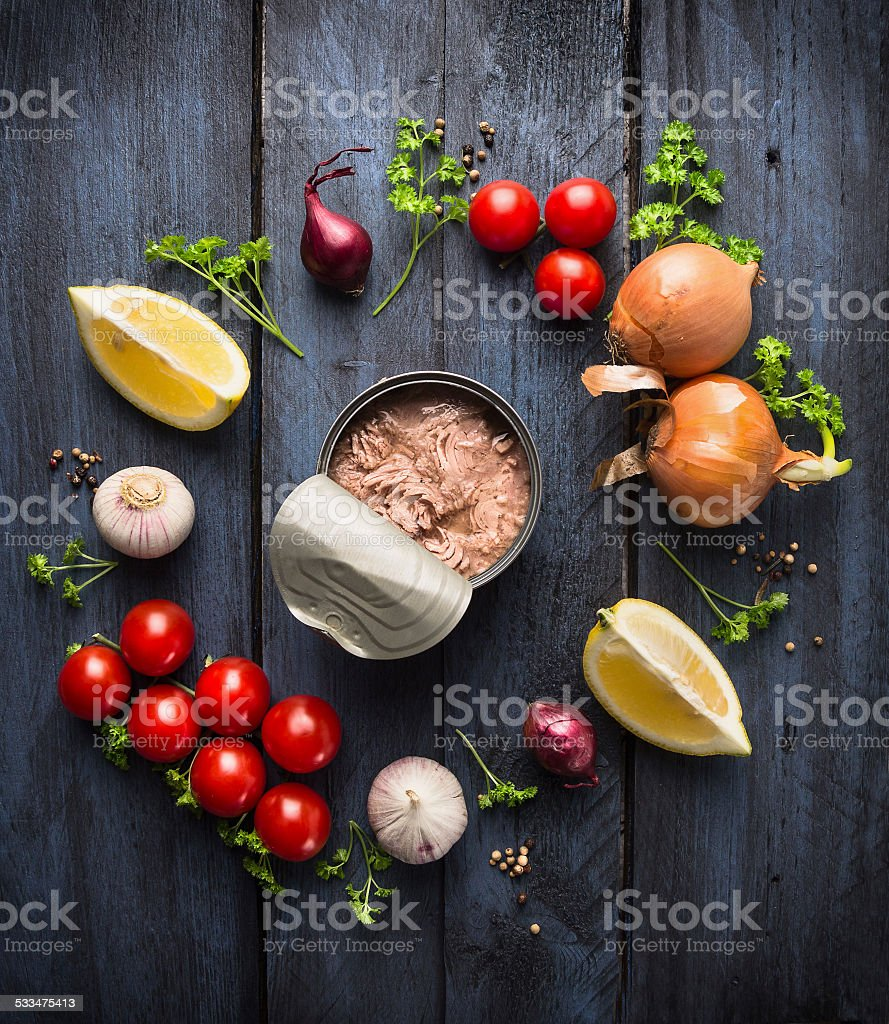 canned  tuna fish and ingredient for tomato sauce stock photo