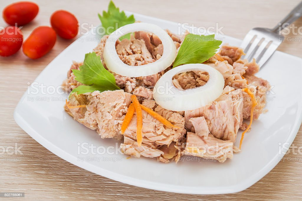 Canned tuna fish on white dish stock photo