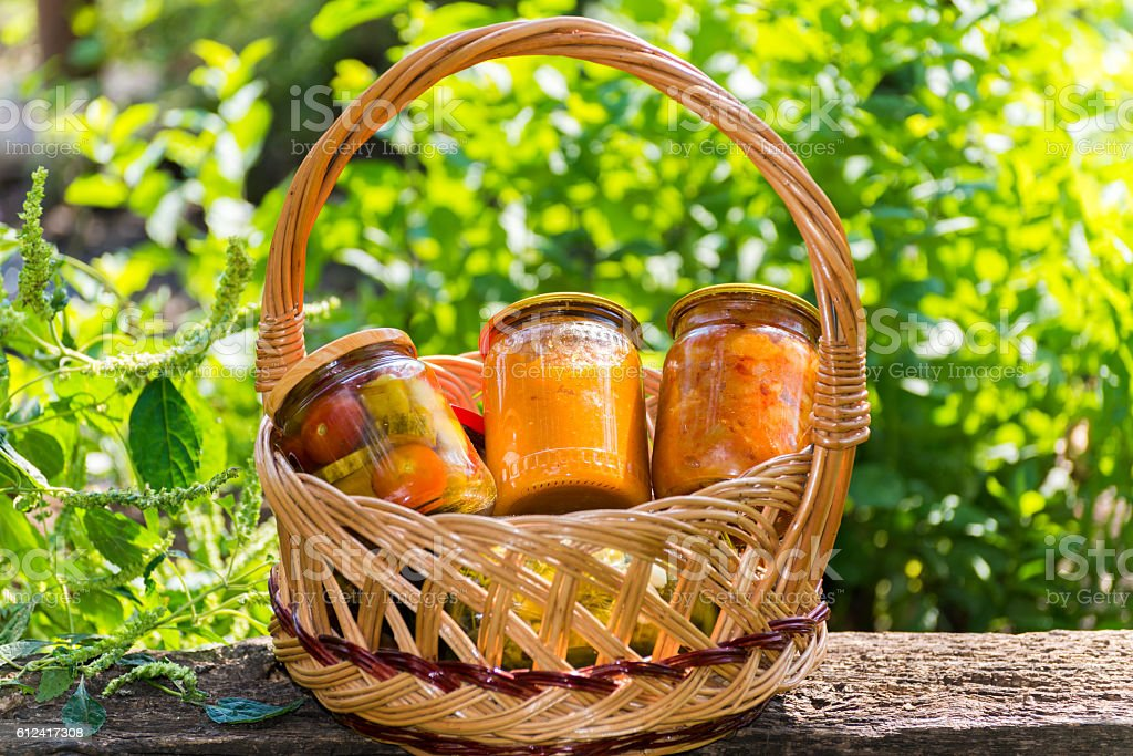 Canned vegetables homemade in wicker basket stock photo