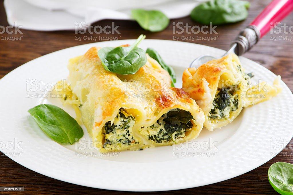 cannelloni ricotta e spinach, selective focus stock photo