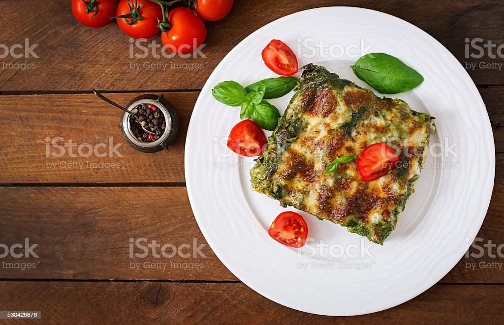Cannelloni with beef and spinach sauce stock photo
