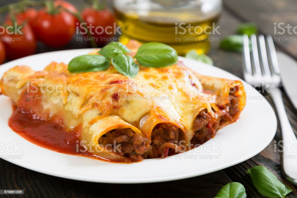 Cannelloni with meat and cheese stock photo