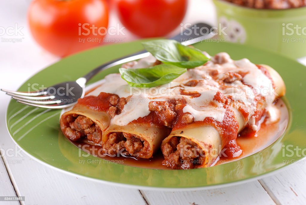 cannelloni with meat sauce stock photo