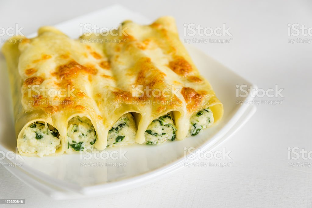 Cannelloni with ricotta and spinach stock photo