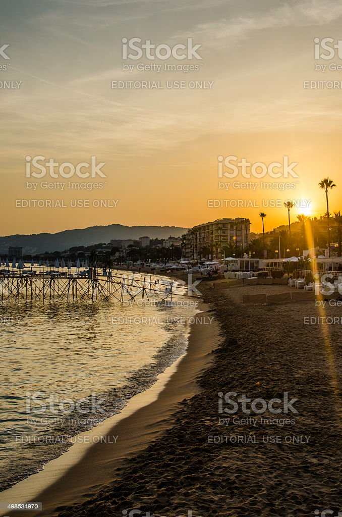 Cannes beach at sunset stock photo