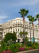 Cannes, France - July 18 2019: Miramar luxury apartments Croisette exterior facade street view travel summer holiday