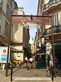 Cannes, France - July 18 2019: Rue Meynadier shopping centre restaurants people cafes travel summer holiday