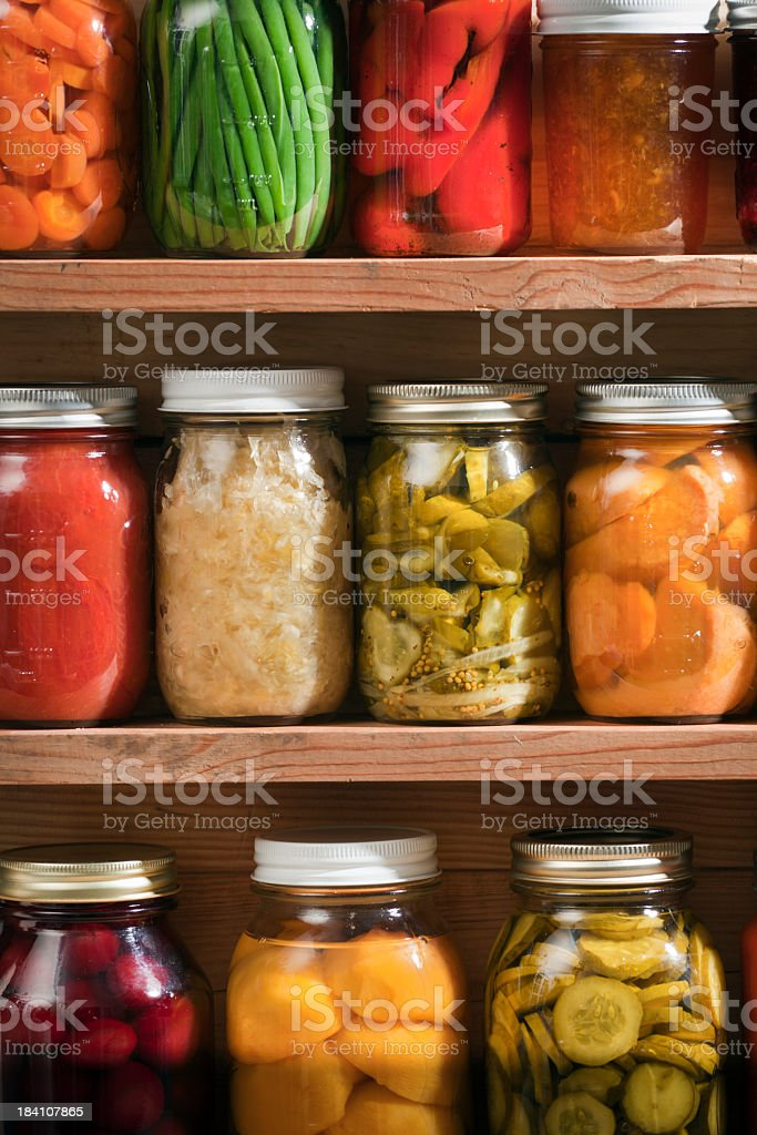 Canning Jars of Canned Food on Shelves, Preserved Vegetable Storage stock photo