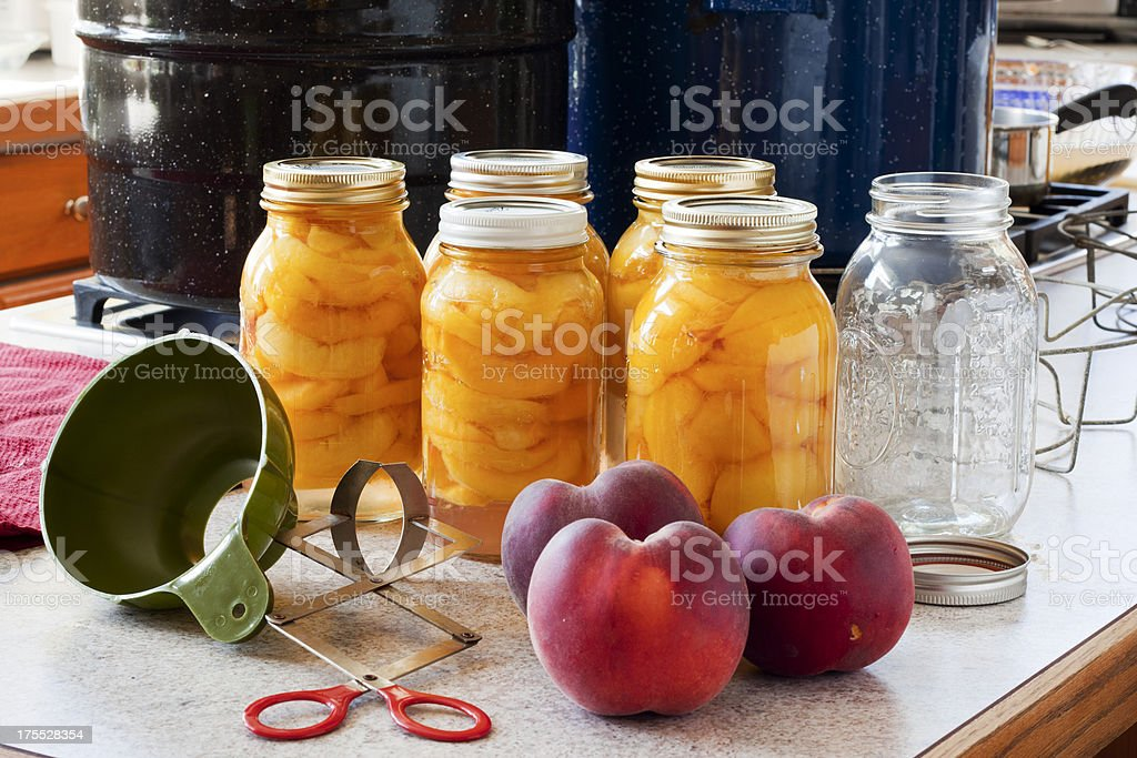 Canning Peaches - Five Full Jars and One Empty stock photo