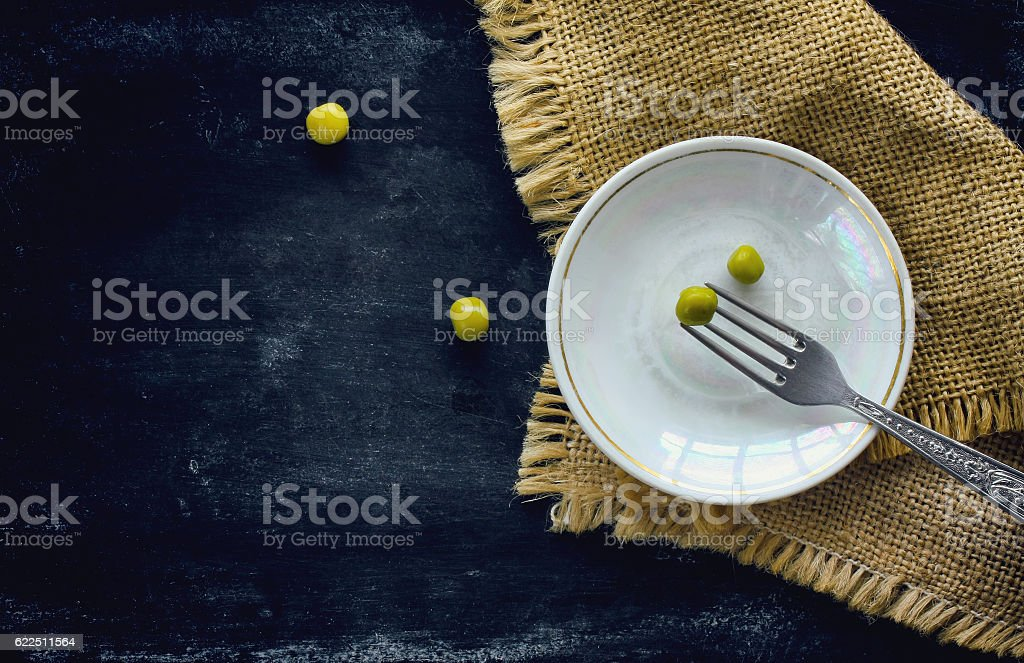 canning peas on fork stock photo