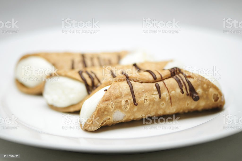 Cannolis on a white plate royalty-free stock photo