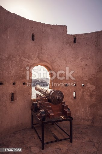 historical cannon at the old watchtower near mutrah in muscat, sultanate of oman.
