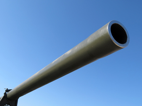 Cannon barrel isolated on clear blue sky background