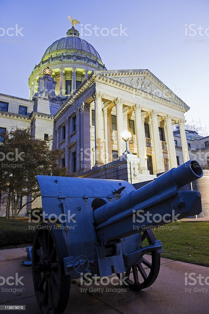 Cannon in front of State Capitol Building stock photo