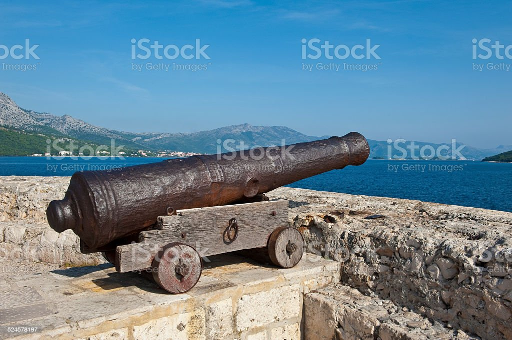 Cannon in the medieval town of Korcula. Croatia stock photo