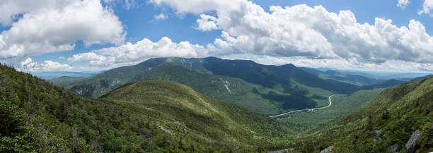 Cannon Mountain Panoramic Panoramic View from Cannon Mountain in Franconia Notch State Park, New Hampshire, USA - showing Interstate 93 in the distance white mountains new hampshire stock pictures, royalty-free photos & images
