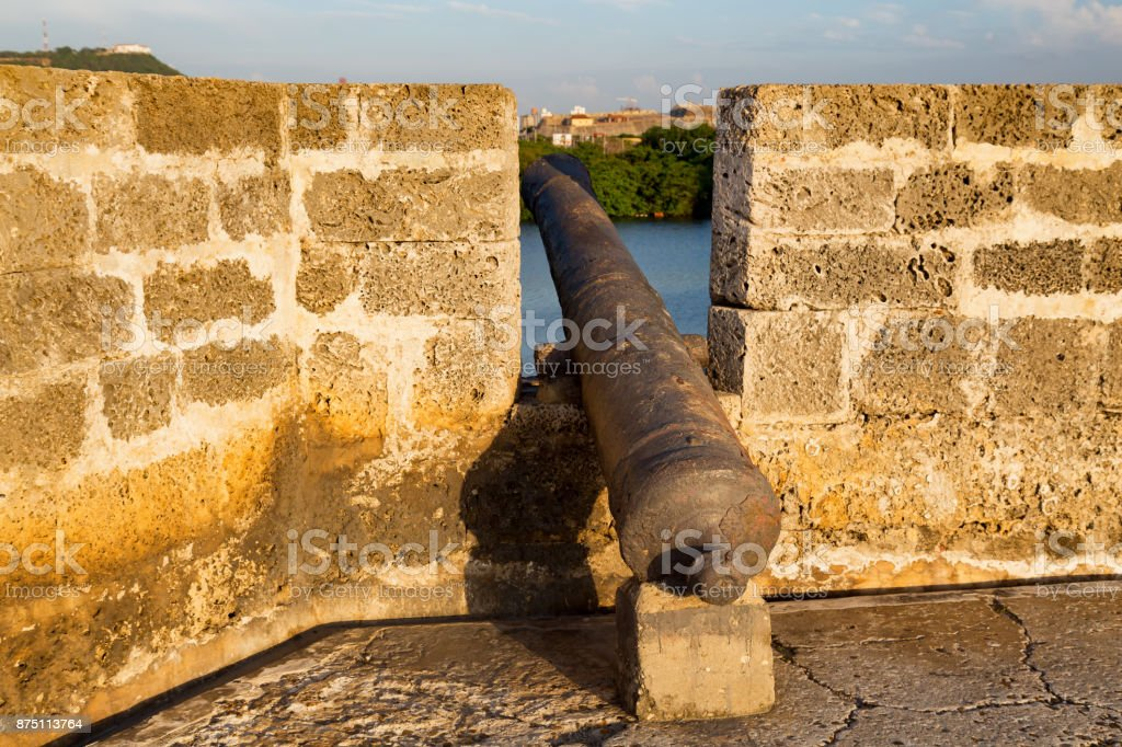 Cannon on a Colonial Wall stock photo