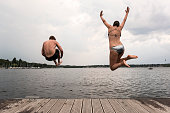 istock Cannonball diving: young adults jump into Wannsee lake 1170452866