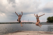 istock Cannonball diving: young adults jump into Wannsee lake 1170452878