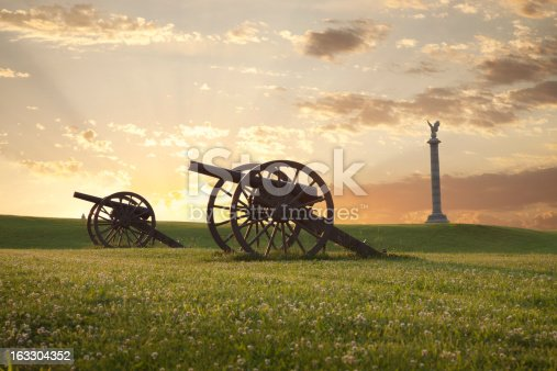 A pair of cannons at sunset on the Antietam National Battlefield near Sharpsburg, Maryland