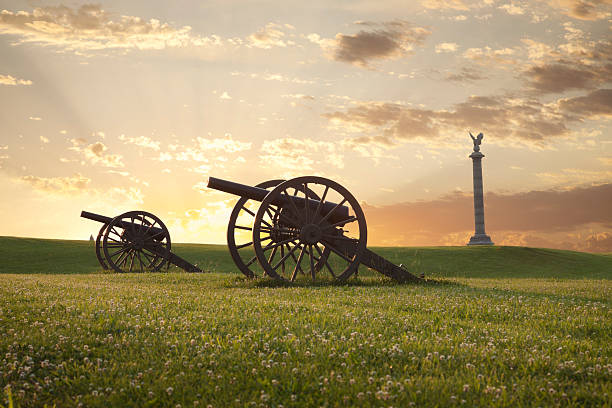 Cannons at Antietam (Sharpsburg) Battlefield in Maryland A pair of cannons at sunset on the Antietam National Battlefield near Sharpsburg, Maryland american civil war stock pictures, royalty-free photos & images
