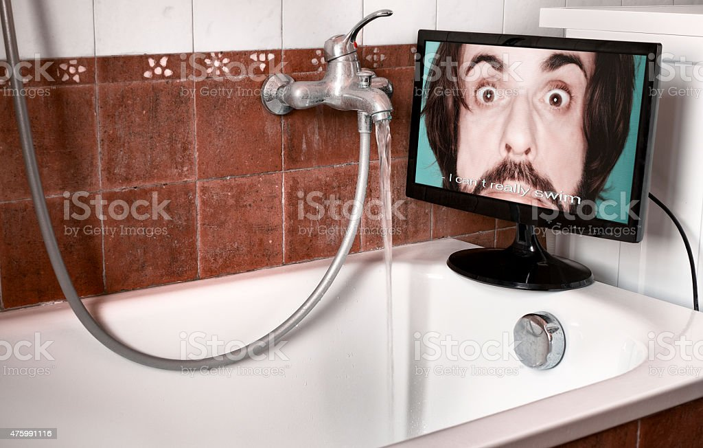I cannot really swim - Swimming in bathtub stock photo