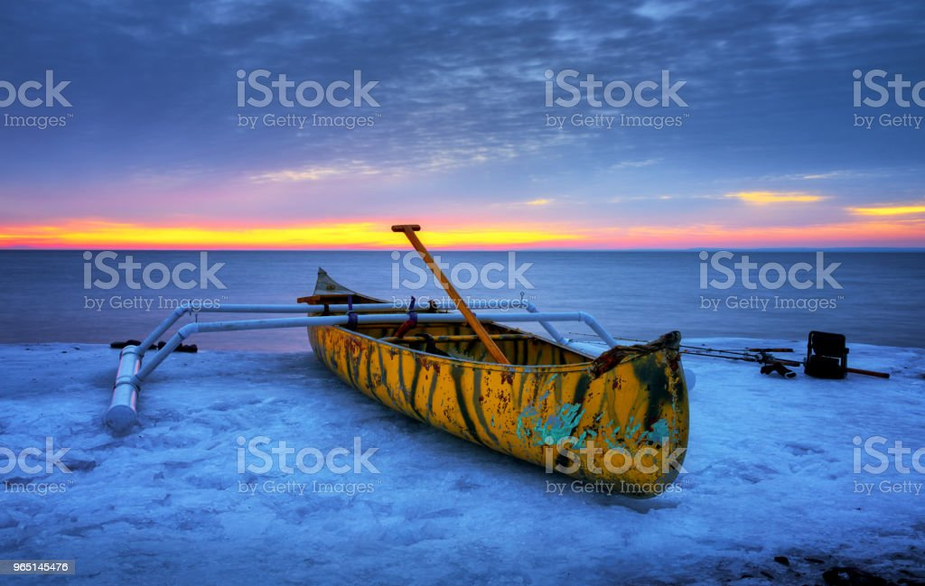 Canoe and boat in the snow at Brighton Beach Duluth Minnesota Lake Superior zbiór zdjęć royalty-free