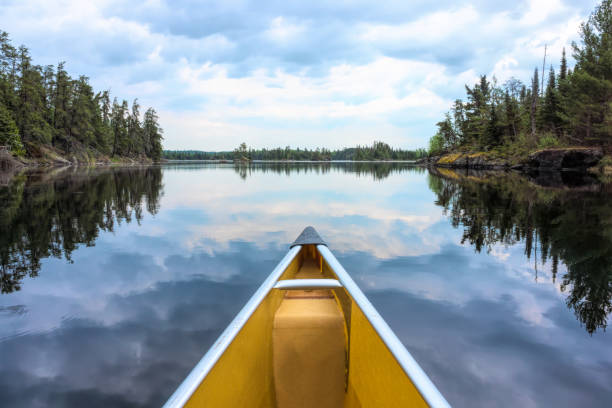 Canoe and lake reflections in Minnesota Lake, Refection, Cloudscape, Sky, minnesota stock pictures, royalty-free photos & images