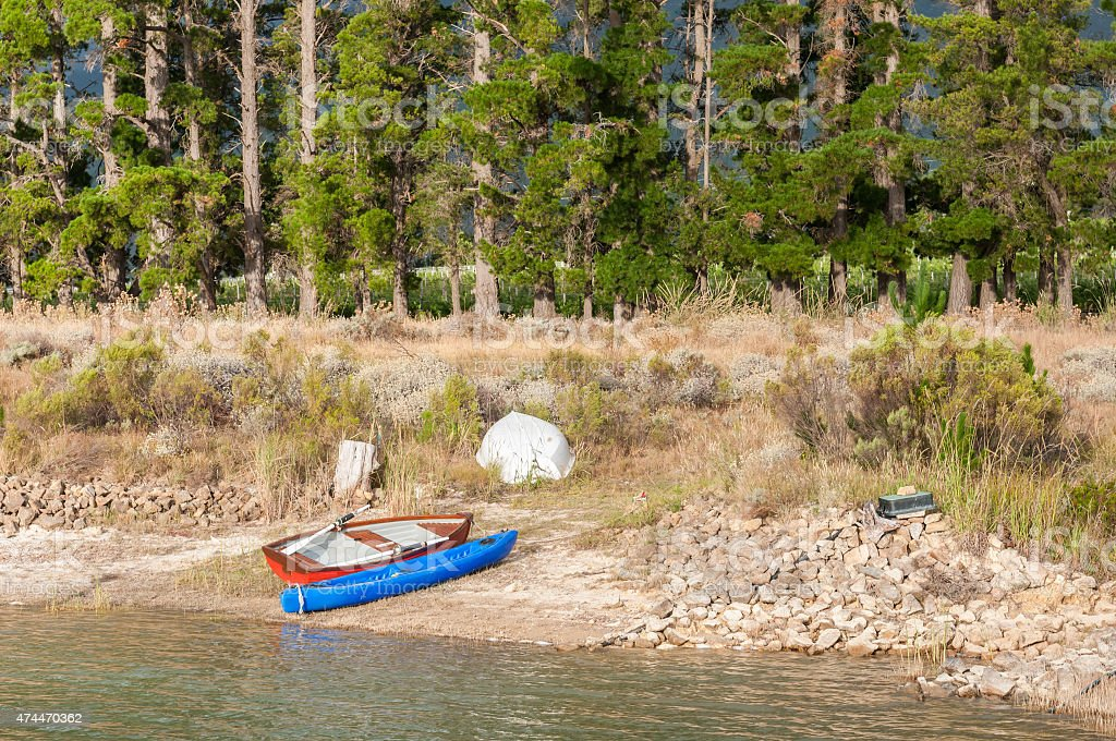Canoe and rowing boats at a dam near Somerset West stock photo