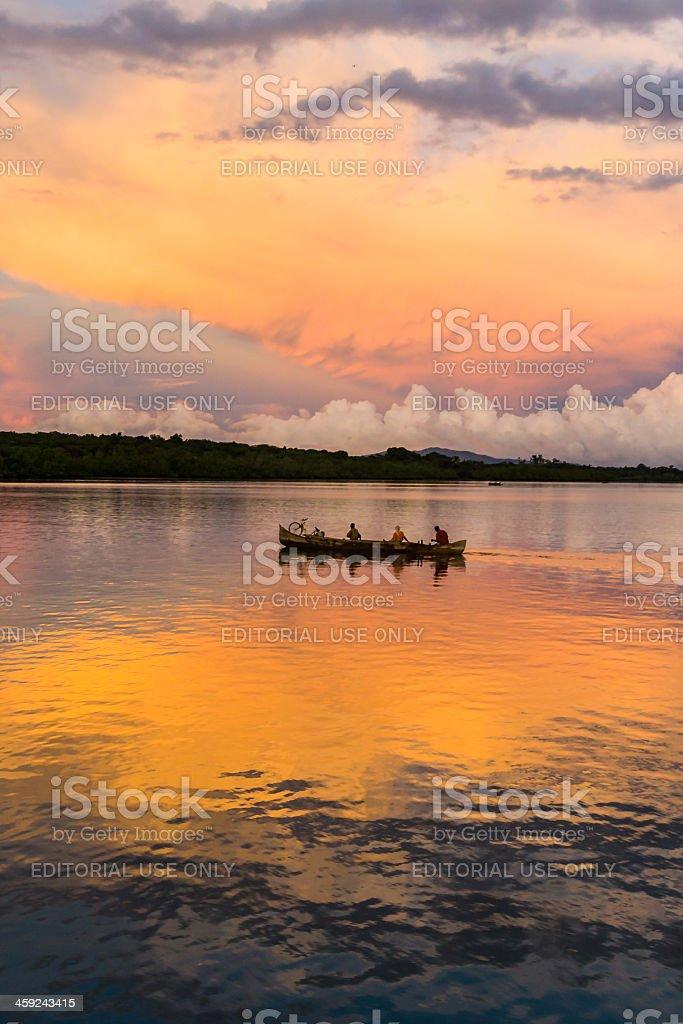 Canoe at sunrise stock photo