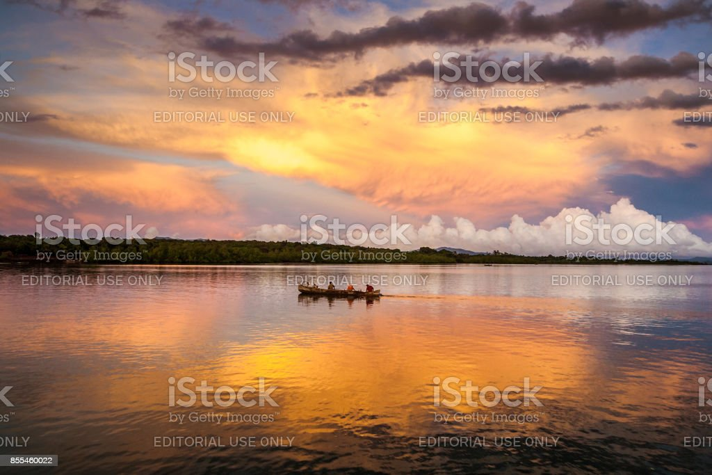 Canoe at sunrise stock photo
