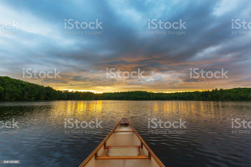 Canoe bow on a Canadian lake at sunset stock photo