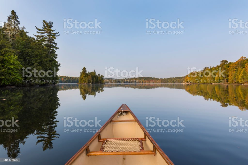 Canoe bow on a lake in late summer stock photo