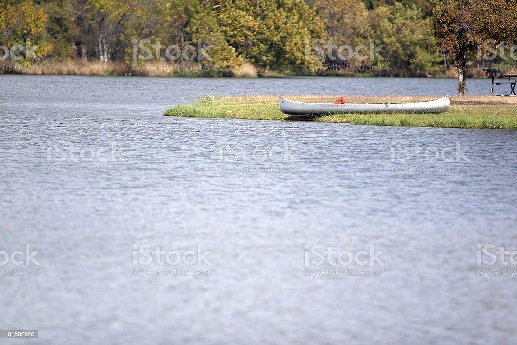 Canoe by Lake stock photo