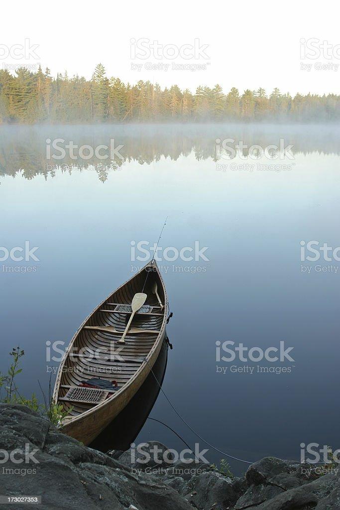 Canoe by the Shore stock photo