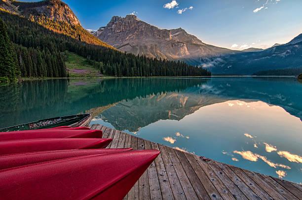 Canoe Dock with Mountain Reflection stock photo